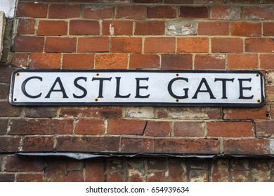 LEWES, UK - MAY 31ST 2017: Street sign for Castle Gate in the historic town of Lewes in East Sussex, UK, on 31st May 2017.