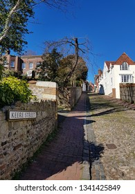"Lewes,East Sussex/UK 02-25-19 A beautiful winter's day with a clear blue sky. The bottom end of the steep, historic, cobbled Keere Street in Lewes. A  ""No through road"" to preserve its beauty"