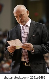 LEWISBURG, PA. - NOVEMBER 28: Penn State's Coach Pat Chambers looks at his notes during a basketball game against Bucknell  on November 28, 2014  Sojka Pavilion in Lewisburg, PA.
