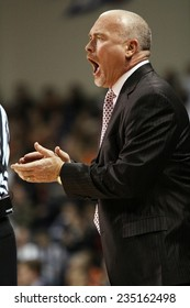 LEWISBURG, PA. - NOVEMBER 28: Penn State's Coach Pat Chambers encourages his players during a basketball game against Bucknell  on November 28, 2014  Sojka Pavilion in Lewisburg, PA.