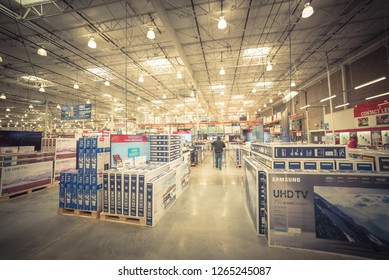 LEWISVILLE, TX, USA-NOV 26, 2018:Customer shopping for 4K, UHD, LED TV at Costco Wholesale store. American multinational corporation operates a chain of membership-only warehouse clubs