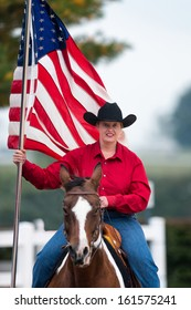 LEXINGTON, KENTUCKY - OCTOBER 29: Woman riding with American flag on October 29, 2013 in Lexington, Kentucky