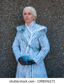 Lexington, Kentucky, US - March, 23 2019 - Lexington Comic and Toy Con - A cosplayer is dressed as Daenerys Targaryen from Game of Thrones wearing a heavy white coat and posed against a stone wall
