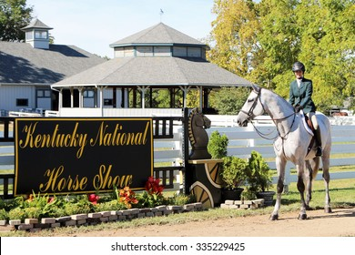 LEXINGTON, KY-OCTOBER, 2015:  Young jockey exercising her horse at the Kentucky National Horse Show.