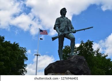 Lexington, MA - 6/6/16: The Minuteman stands guard over Lexington's historic battle green.