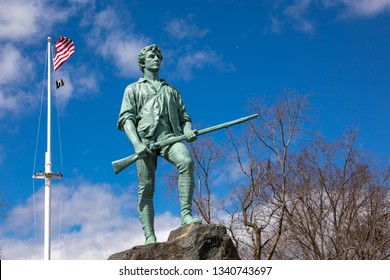 Lexington, MA / USA - March 16 2019: Minuteman statue at Lexington Green - shifted left for text