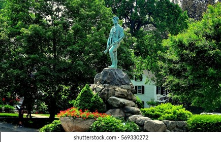 Lexington, Massachusetts- July 10, 2013: Minuteman statue of Captain John Parker on the Village Green where the Battle of Lexington ignited the American Revolution on 19 April 1775  *
