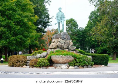Lexington, USA - October 6, 2018 - The Minuteman statue (Captain John Parker) in Lexington Battle Green, Massachusetts