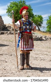 Lezuza, Spain - June 9, 2019: anonymous actor in a reenactment represented as a roman optio, a position in a centuria, right under the centurion
