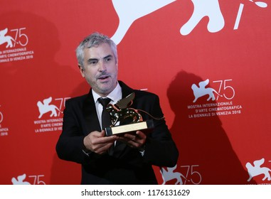 lfonso Cuaron poses with Golden Lion for the best movie fo 'Roma' at the Winners Photocall during the 75th Venice Film Festival at Sala Grande on September 8, 2018 in Venice, Italy.