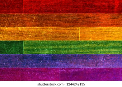 LGBT civil rights rainbow flag painted on wood planks. Copy space for text or graphic. Concept for gay civil rights, same sex marriages, gender neutrality, homophobia, lgbt community