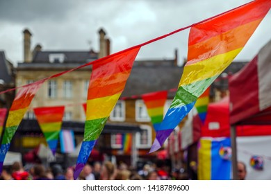 LGBT flags on main stage of Pride Festival Weekend in Love Northampton Market Square UK