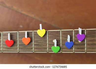 LGBT hearts on the strings of a guitar reef. Symbol gay, lesbian, bisexual, transgender love. Lgbtq rights concept