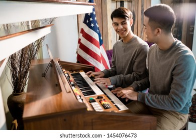 LGBT Male homosexual is playing the piano. Happily with his lover