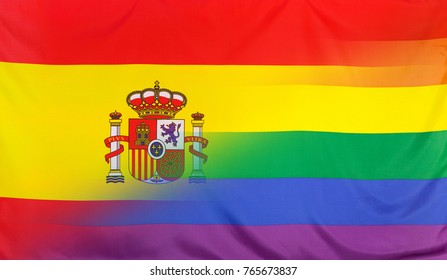 LGBT movement concept with fabric rainbow flag merged with real textile flag of Spain