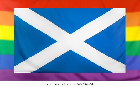 LGBT movement concept with real textile flag of Scotland placed within a blurred rainbow flag background