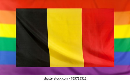LGBT movement concept with real textile flag of Belgium placed within a blurred rainbow flag background