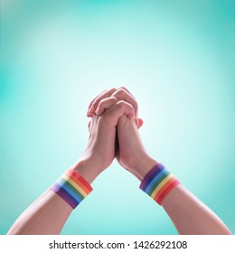 LGBT pride month with rainbow flag ribbon  on LGBTQ people holding hands (isolated with clipping path) for International day against homophobia and transphobia