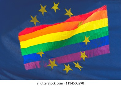 LGBT Rainbow flag blended with European Union Flag, Double Exposure of Rainbow Flag and Blue Flag with Stars, Abstract photography shallow depth of field
