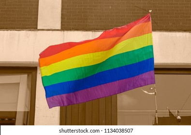 LGBT Rainbow flag isolated on sepia tone background, shallow depth of field