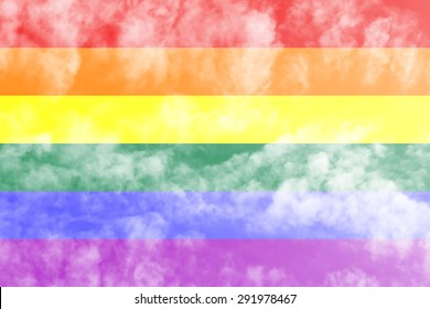 LGBT rainbow gay flag over sky background.
