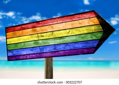 LGBT in a Rainbow wooden sign with a beach background
