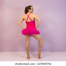 LGBT, young transgender girl in a sexy pose and wearing a pink tutu, portrait of a ballet dancer