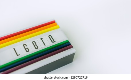 LGBTQ word on light box and Color pencils on white background.LGBTQ is Lesbian, Gay, Bisexual, Transsexual, Queer.