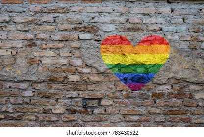 LGTB heart shape flag on brick wall texture