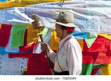 LHASA - AUGUST 8: Tibetan pilgrims circle the Potala palace on August 8, 2010 in Lhasa. Some devotees walk 108 times around the Potala for good luck