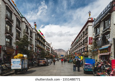 Lhasa, China - April 4, 2019: Pedestrians walk down one of the sidestreets of Lhasa, the capital of Tibet Autonomous Region in China.