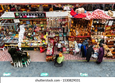 Lhasa, China - December 12 2018: People shop for traditional goods and handicrafts in the  Dropenling market in Lhasa in Tibet.
