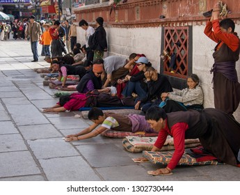 Lhasa. Tibet. 10.03.06. Tibetan Buddhist pilgrims outside the Jokhang Temple on Barkhor Square in Lhasa, Tibet. Tibetans, consider this temple the most sacred and important temple in Tibet.
