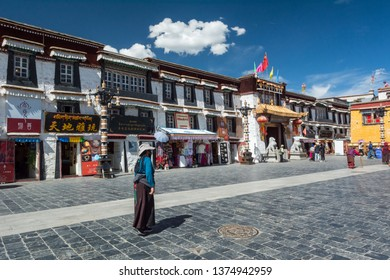 Lhasa, Tibet - 22 JUN 2019: Tourists are travelling at Pargor Subdistrict located in Lhasa, Tibet. Sunny blue sky with clouds. Wide angle.