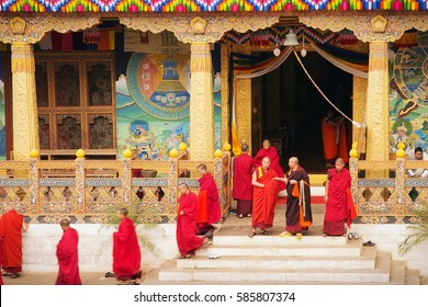 Lhasa, Tibet - April 29, 2012: Tibetan monks leave the main entrance of the old buddhist monastery temple after prayer, Lhasa, Tibet, Asia