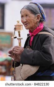 LHASA, TIBET - AUGUST 8: Unidentified Tibetan pilgrim circles the Potala palace on August 8, 2010 in Lhasa, Tibet. Devotees walk 108 times around the Potala for good luck.