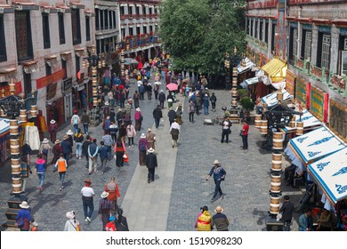 LHASA, TIBET / CHINA - Aug 3, 2017: View on one of the main streets of Lhasa, close to Barkhor street and Jokhang temple. Many pilgrims walking around, shops on the right and left side of the street.