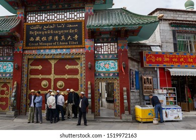 "LHASA, TIBET / CHINA - Aug 3, 2017: Muslim men standing in front of the entrance gate of the ""Great Mosque of Lhasa Tibet"". Muslims are a minority in China (mainly living in Tibet and Xinjiang)."