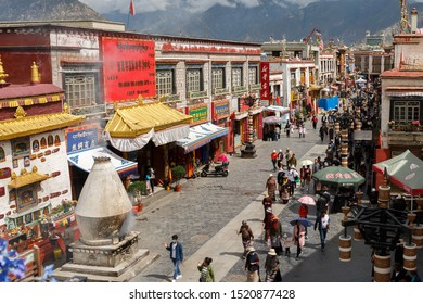 LHASA, TIBET / CHINA - Aug 3, 2017: View on Barkhor street - in the city center of Lhasa. Pilgrims walk the Kora, which means encircling Jokhang temple (center of Tibetan Buddhsim). Colorful buildings