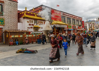 LHASA, TIBET / CHINA - August 1, 2017: Pilgrims walking along Barkhor street. Practicing the traditional Kora - a type of pilgrimage and a type of meditative practice in Tibetan Buddhism.