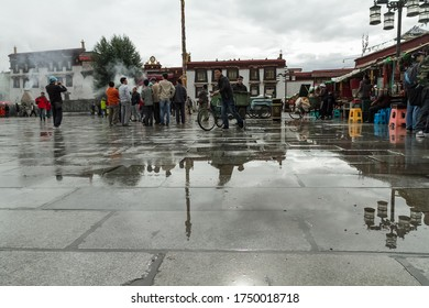 Lhasa, Tibet / China - August 20, 2012: the Barkhor Square in Lhasa, Tibet. The square is crowded with tourist looking for local arts and crafts.