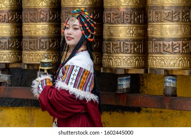 Lhasa, Tibet, China, Chengguan District, June 27 2019: closeup of beautiful young make up girl wearing traditional Tibetan clothes and jewelry