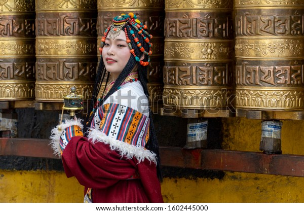 Lhasa, Tibet, China, Chengguan District, June 27 2019: closeup of beautiful young make up girl wearing traditional Tibetan clothes and jewelry