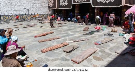 LHASA, TIBET / CHINA - Jul 30, 2017: Mats / large pillows in front of Jokhang temple. Used for prostration by buddhist pilgrims: Dropping the body forward and stretching it full length on the floor.