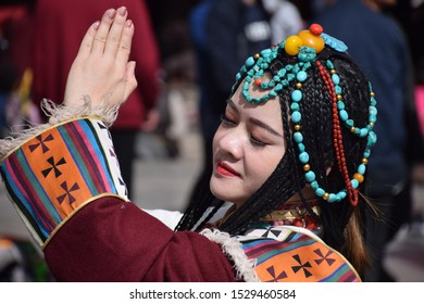 LHASA, TIBET, CHINA - SEPTEMBER 30 - Beautiful asian girl takes photo shoot dressed with traditional tibetan clothes on september 30, 2019 in Lhasa
