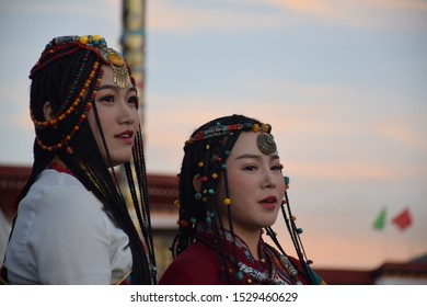 LHASA, TIBET, CHINA - SEPTEMBER 30 - Two beautiful asian girls take photo shoot dressed with traditional tibetan clothes on september 30, 2019 in Lhasa