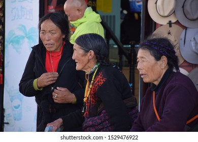 LHASA, TIBET, CHINA - SEPTEMBER 30 - Three old tibetan women in traditional clothes nearby Jokhang temple on september 30, 2019 in Lhasa