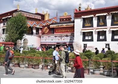 LHASA, TIBET, CHINA - SEPTEMBER 30 - Tibetan people walk around Barkhor street nearby Jokhang temple on september 30, 2019 in Lhasa