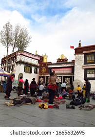 Lhasa, Tibet - November 12 2013 : Tibetan people are doing prostration in front of Jokhang temple which is the most important temple in Lhasa.