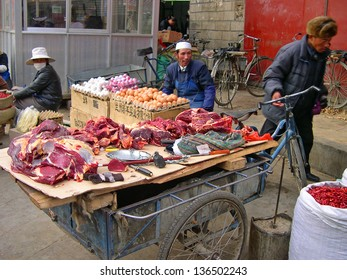LHASA, TIBET-NOVEMBER 12: vendor selling meat in Barkhor Street. The ancient street is a symbol of Lhasa and a must see place for visitors. November 12, 2004 in Lhasa, Tibet